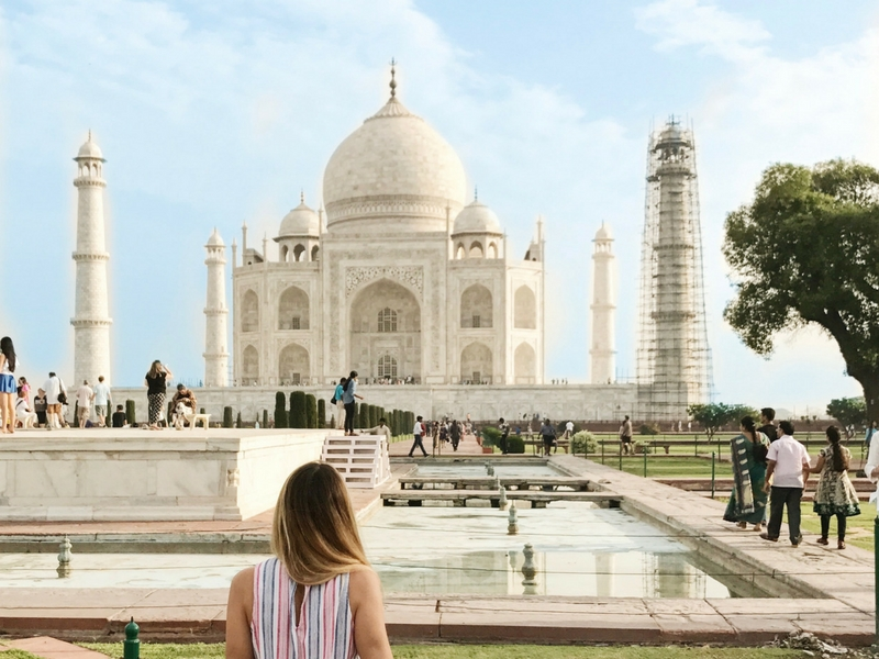 girl sitting in front of taj mahal