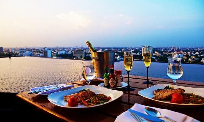 dinner at roof top hotel with swimming poodl - honeymoon tour in delhi